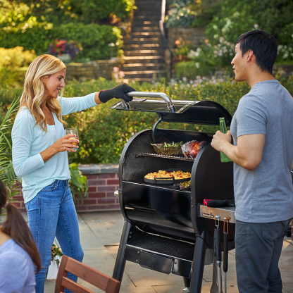 Entertain with the Give food a smoke flavour on the Weber SmokeFire EX4 GBS Wood Fired Pellet Grill in Black