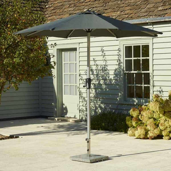 25kg Bramblecrest Granite Parasol Base shown with a parasol (not included)