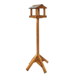 This stunning Tom Chambers Malham bird table is crafted from responsibly managed timber. It features a slate roof with a decorative finial, adding charm to any outdoor space. Main Features Slate roof to keep the rain off the feeding table Height: 190cm Shaped rims and roof uprights