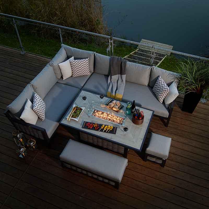 3 pattern & 3 plain garden scatter cushions on a garden lounge set