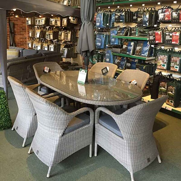 4 Seasons Outdoor Sussex 6 Seat Oval dining Set in Polyloom Pebble & Riviera Charcoal with Parasol and Base