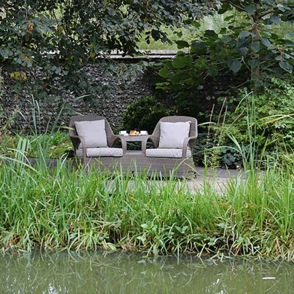 4 Seasons Outdoor Sussex Love Seat in Polyloom Taupe