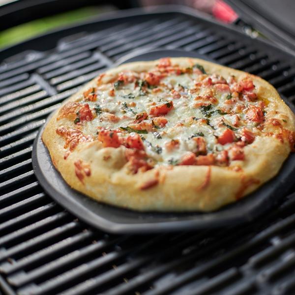 Use Weber Barbecue Premium Grilling Stone (26cm) to prepare a delicious pizza