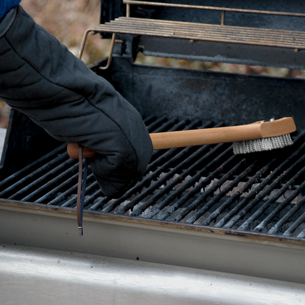 Use the Weber Barbecue Grill Mitt to handle barbecue tools