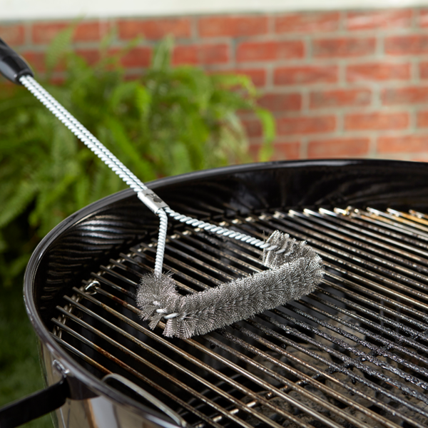 """Clean the grate with Weber's Barbecue Grill Brush (53cm/21"""")"""