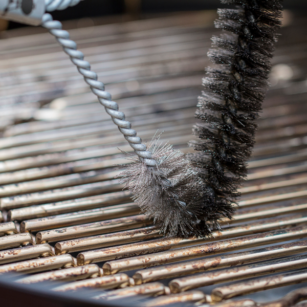 """Use the Weber Barbecue Grill Brush (53cm/21"""") to clean between the grate"""