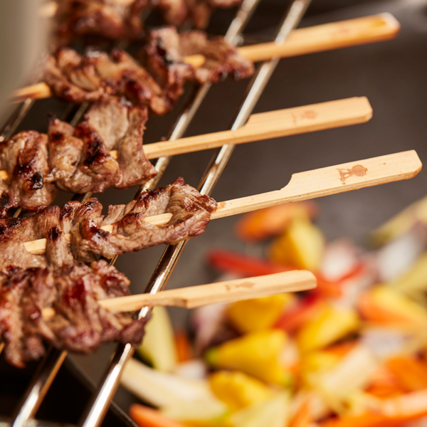 Keep Weber Bamboo Skewers warm on your Weber warming rack