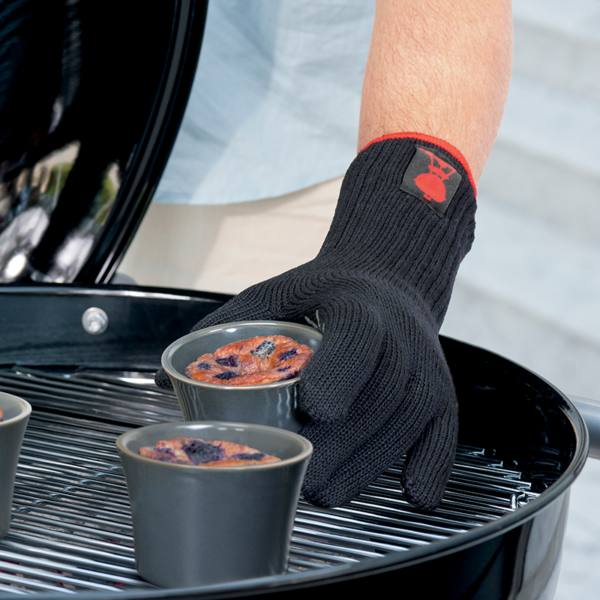 Use Weber Premium Barbecue Gloves - Black (Small - Medium) #6669 to keep hands safe