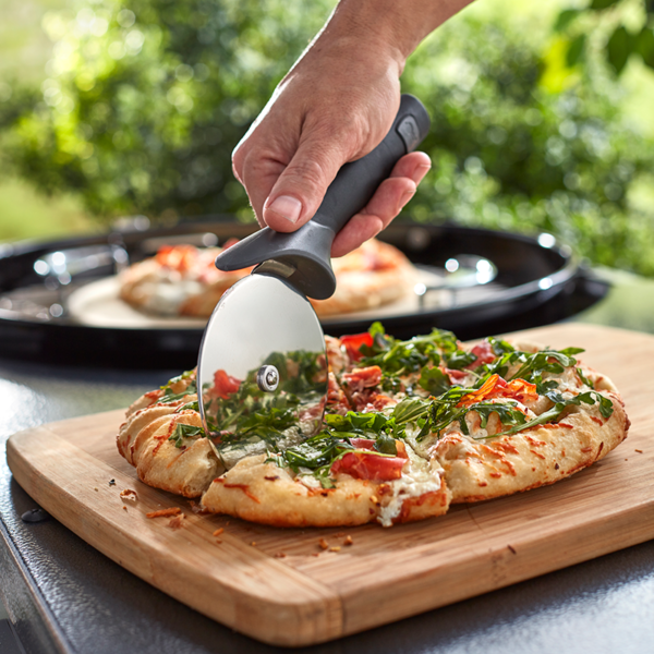 Slice through thick crust with the Weber Pizza Cutter