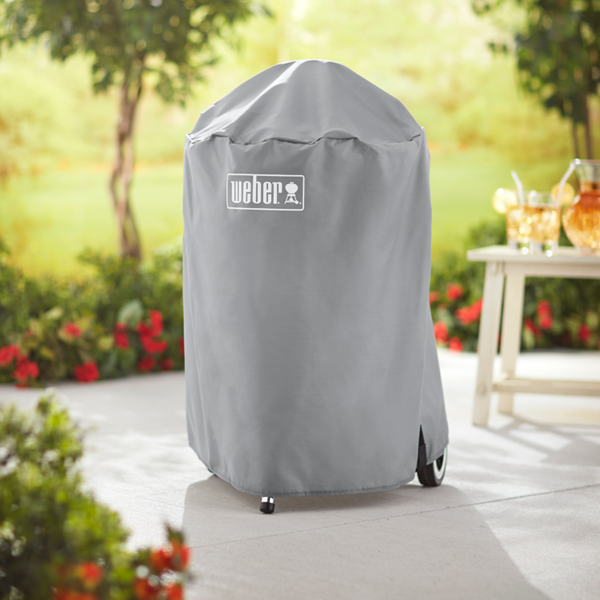 The Weber Barbecue Cover for 47cm Charcoal Barbecues (Grey) can be left outside all year round