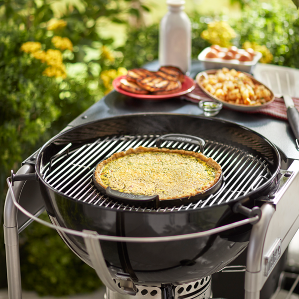 The Weber Barbecue Gourmet BBQ System (GBS) Cast Iron Griddle Plate on a charcoal BBQ GBS Cooking Grate