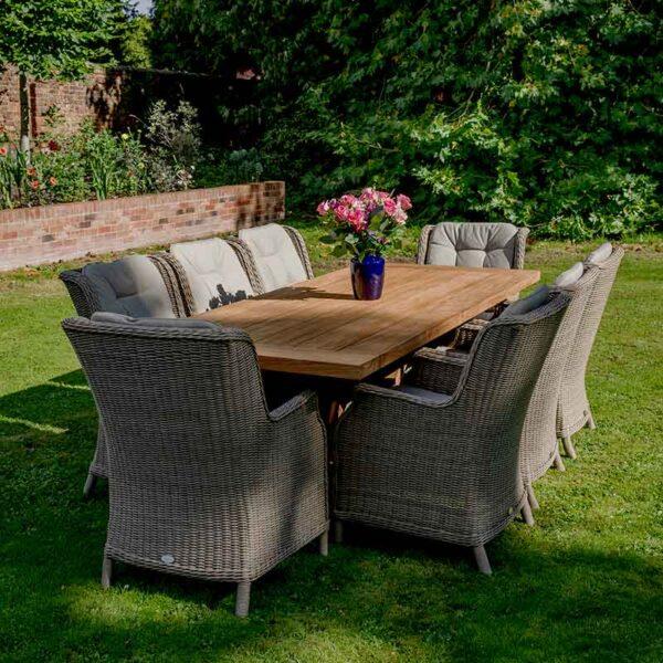 Bramblecrest 8 Seat Dining Set with Kuta Table & Oakridge Armchairs in garden
