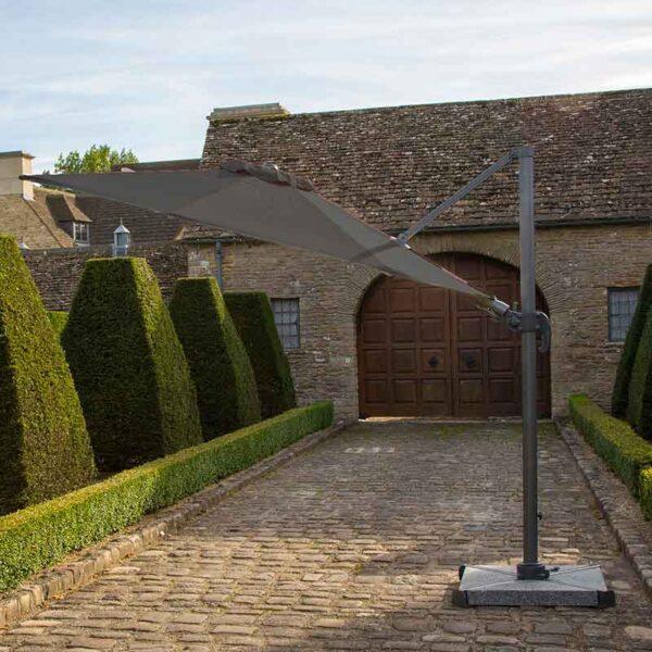 Bramblecrest Chichester 3m Round Side Post Parasol in Grey with Granite Base in garden