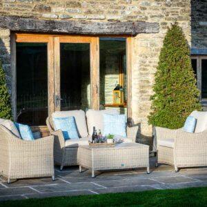 Bramblecrest Monterey 4 Seat Garden Lounge Set with Ceramic Top Coffee Table in Sandstone