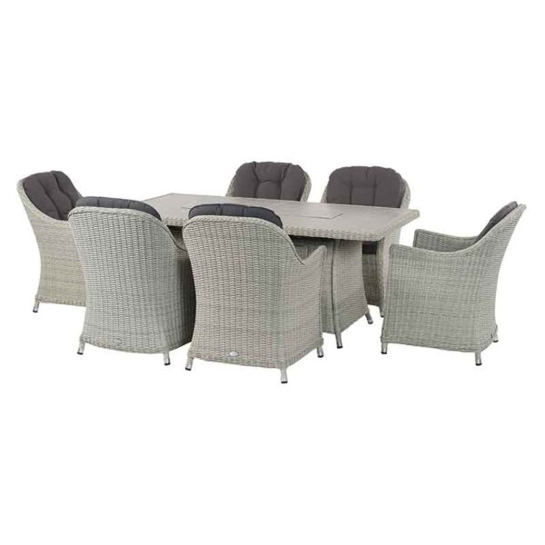 Bramblecrest Monterey 6 Seater Dining Set with Ceramic Firepit Table tucked away