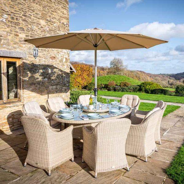 Bramblecrest Monterey 8 Seat Oval Dining Set with Lazy Susan, Parasol & Base in Sandstone