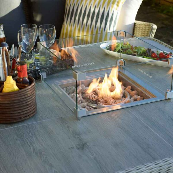 Bramblecrest Monterey Square Casual Dining Table in Dove Grey with Ceramic Top with Firepit lit
