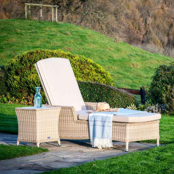 Bramblecrest Monterey Sun-Lounger & High Coffee Table with Ceramic Top in Sandstone in garden