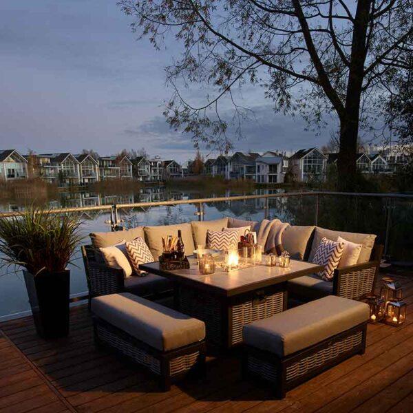 Bramblecrest Portofino Modular Sofa Set with Square Ceramic Top Firepit Table in use
