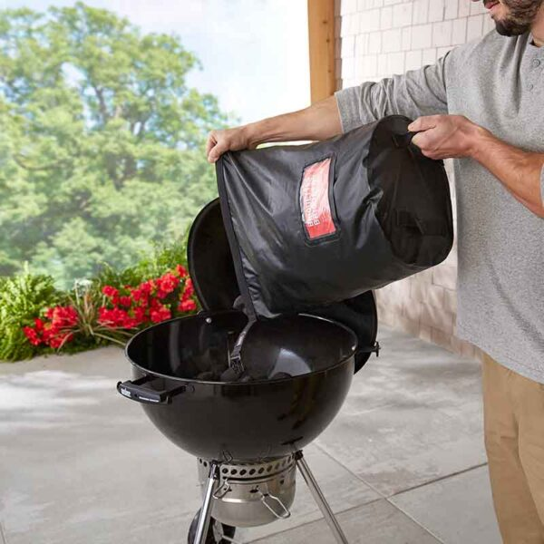 Charcoal pours in easily with the Weber Fuel Storage Bag