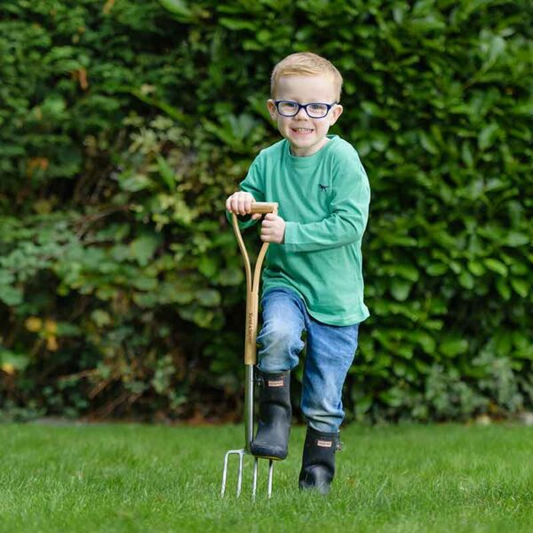 Child using the Kent & Stowe Kids Stainless Steel Digging Fork