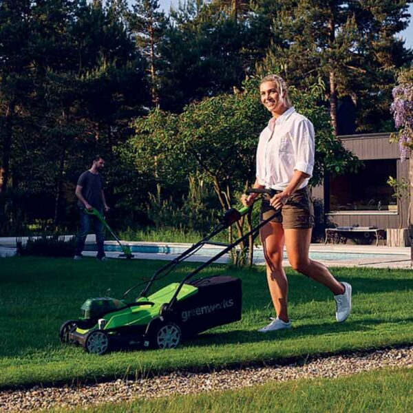 Greenworks 48V 36cm Lawnmower with 2 x 2Ah Batteries & Charger in garden