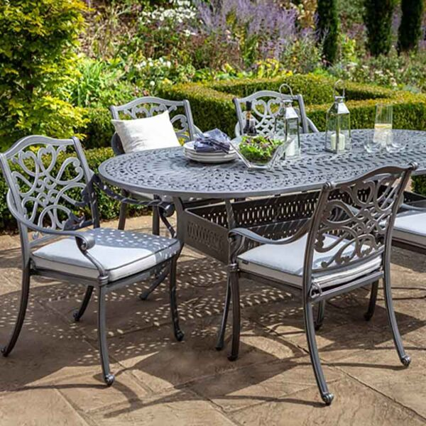Hartman Capri 6 Seat Oval Set in Antique Grey with Platinum Cushions, Parasol and Base on patio