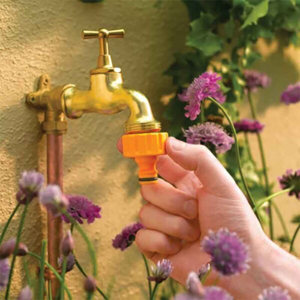 Hozelock 1 inch Outdoor Tap Connector in use
