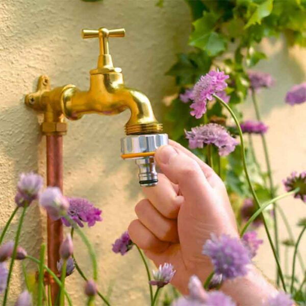 Hozelock 1 inch Pro Metal Outdoor Tap Connector in use