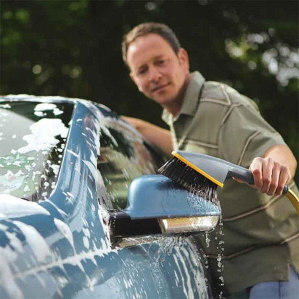 Hozelock Short Car Brush with 10 Soap Sticks in use
