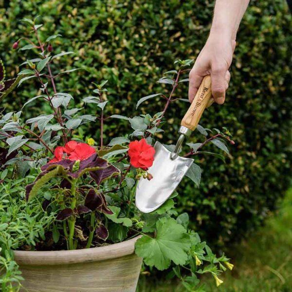 Kent & Stowe Garden Life Hand Trowel in use