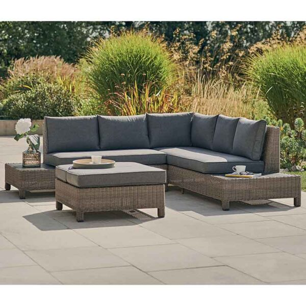 Kettler Palma Low Lounge Set in Rattan shown with coffee table converted for seating