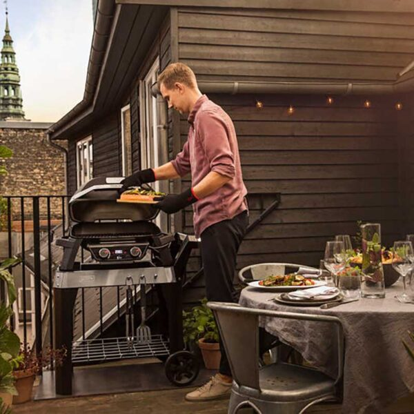 Weber Pulse 2000 Electric Barbecue with Stand on a Balcony