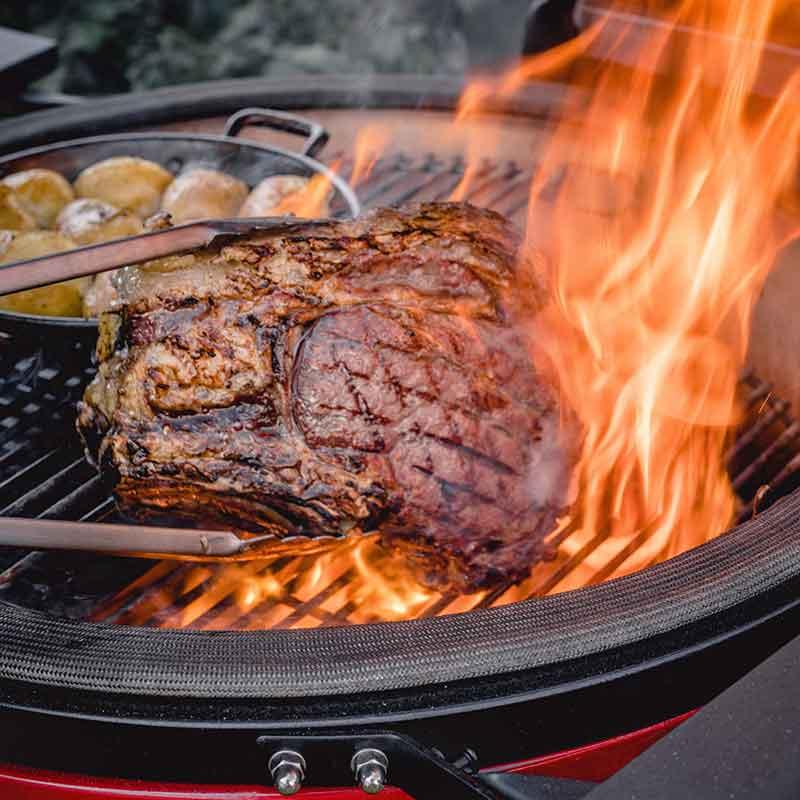 Sear Steak on a charcoal Kamado Joe barbecue