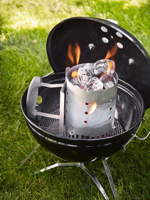 Light your Weber Smokey Joe® Premium Charcoal Barbecue with the Weber Rapidfire Chimney Starter (not included)