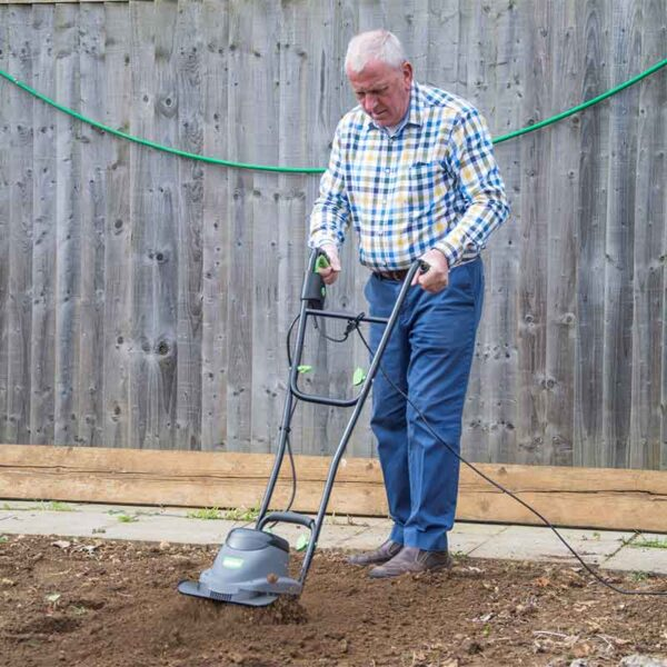The Handy 30cm 800W Electric Tiller in use