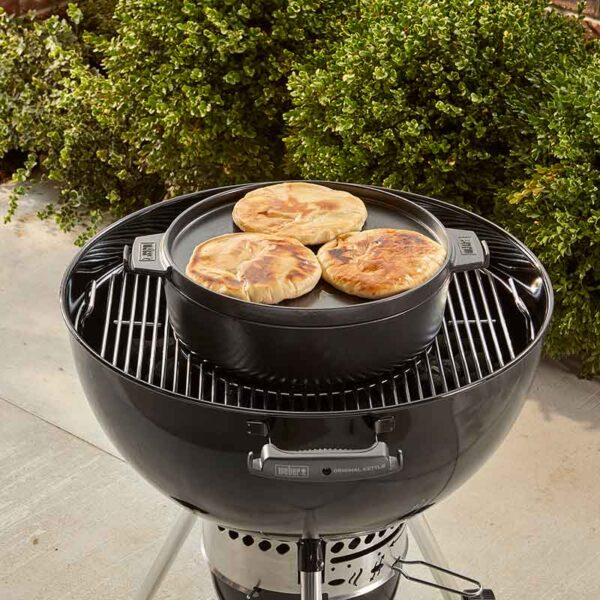 The Weber GBS Dutch Oven Duo on a charcoal BBQ