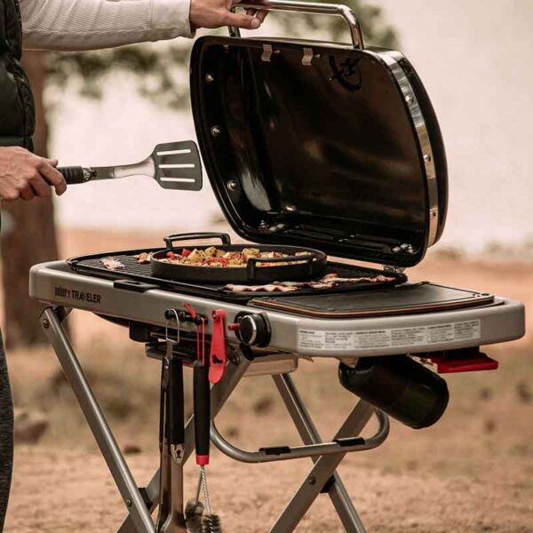 The versatile Weber Traveler shown with Weber accessories (not included)