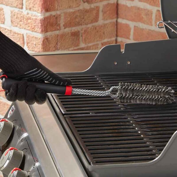 Weber Detail Barbecue Brush cleaning cooking grate on gas BBQ