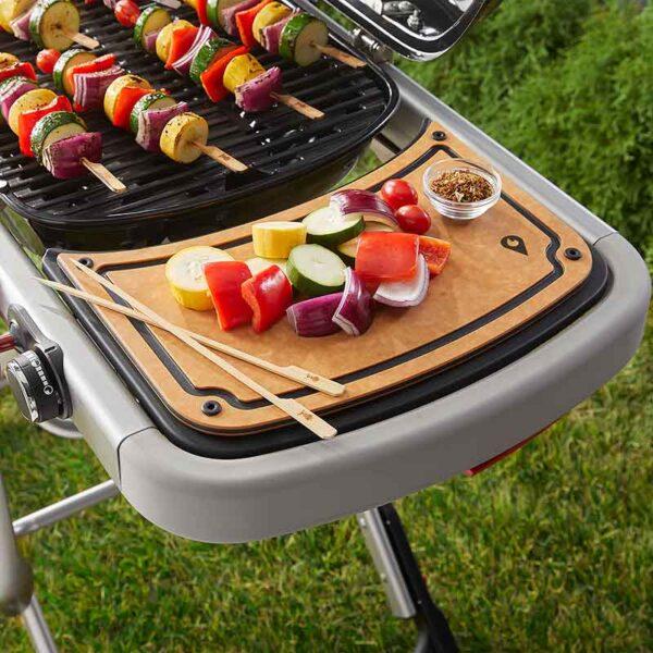 Weber Traveler Reversible Prep & Serve Board in use