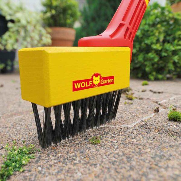 Wolf Garten multi-change Weeding Brush in use