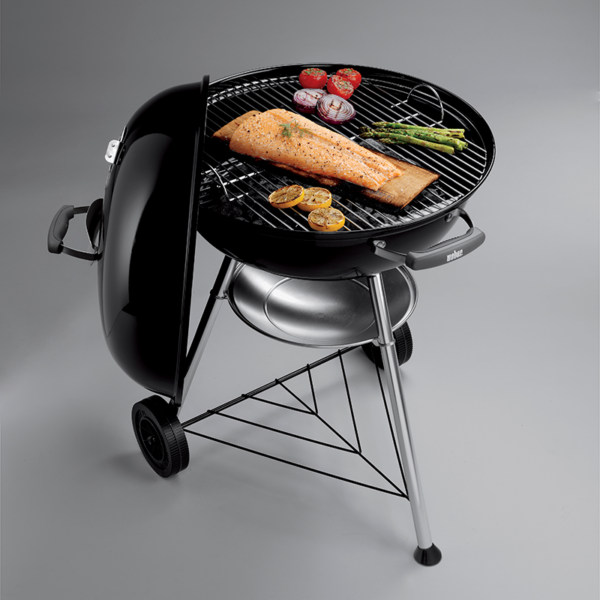 Cook something delicious on the Weber Compact Kettle Charcoal Grill Barbecue 57cm (Black)