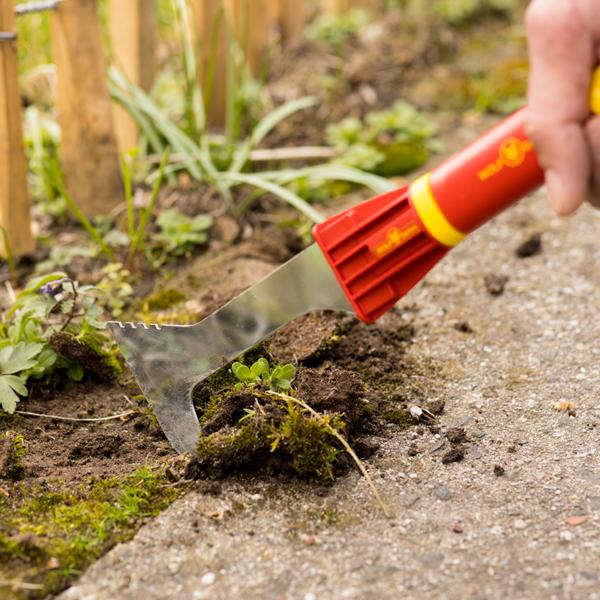 Using Wolf Garten multi-change Garden Scraper