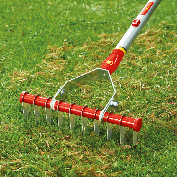 Using the 30cm wide Wolf Garten multi-change Moss Removal Rake