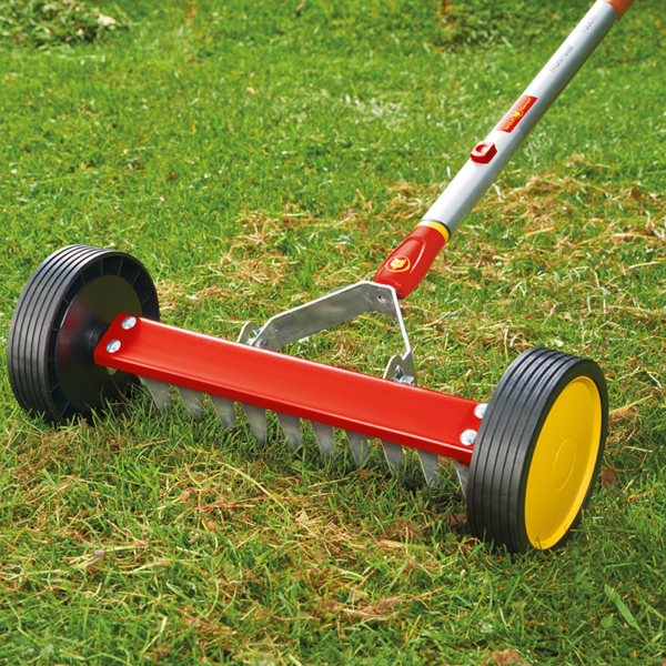 Using Wolf Garten multi-change Roller Moss Removal Rake
