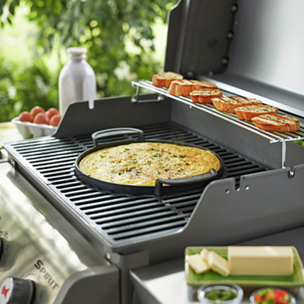 Use the Weber Barbecue Gourmet BBQ System (GBS) Cast Iron Griddle Plate on a gas BBQ with a GBS cooking grate