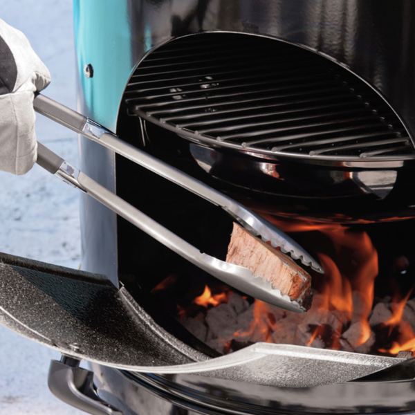 Use Weber Barbecue Premium Tongs to add flavour wood chunks to your barbecue